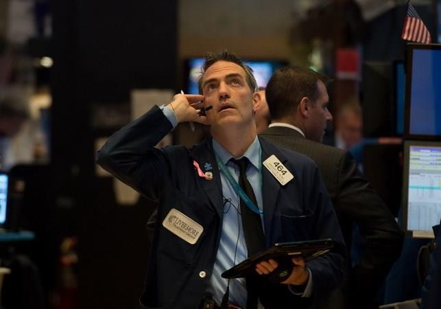 Chứng khoán Mỹ phản ứng trái chiều sau khi Fed giữ nguyên lãi suất