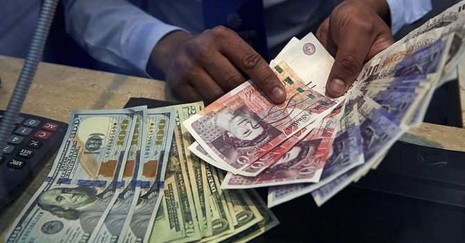 Đồng USD trồi sụt sau báo cáo việc làm Mỹ