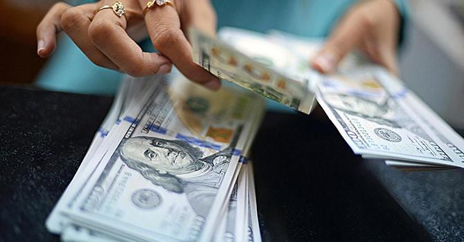 Đồng USD mất giá khi chứng khoán toàn cầu phục hồi