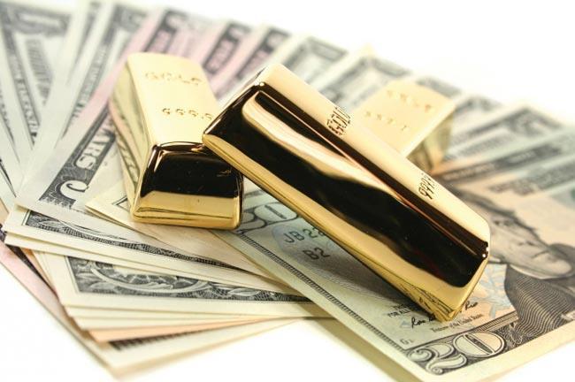 Đồng USD phục hồi, giá vàng lùi khỏi đỉnh 1 tuần