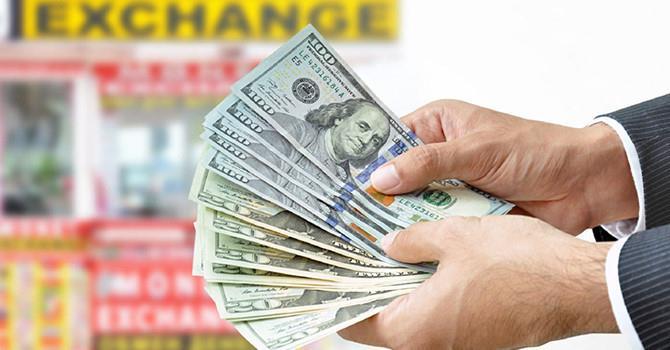 Tỷ giá trung tâm giảm, ngân hàng tăng nhẹ giá USD