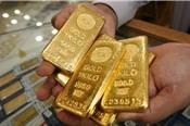 Chứng khoán và USD giảm, giá vàng hướng về đỉnh 5 tháng